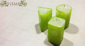 A set of green polka dotted candles