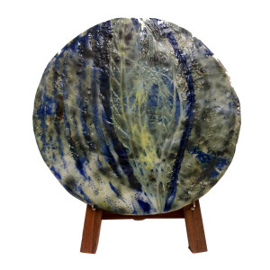 Graceful table accent is what this meticulously designed abstract plate is all about.